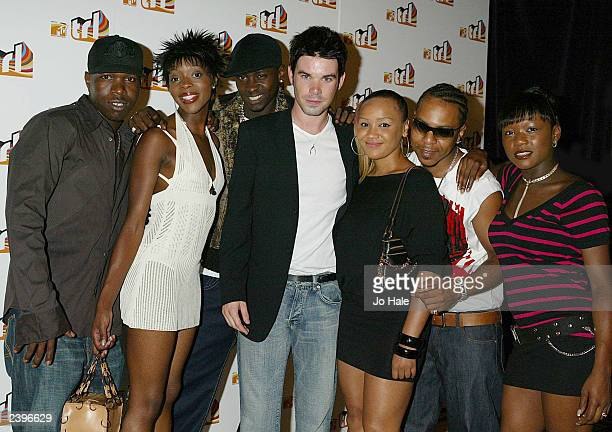 Group Big Brovaz and Dave Berry host of TRL attend the launch of MTV's TRL August 12 2003 at the In and Out Club in Piccadilly London England