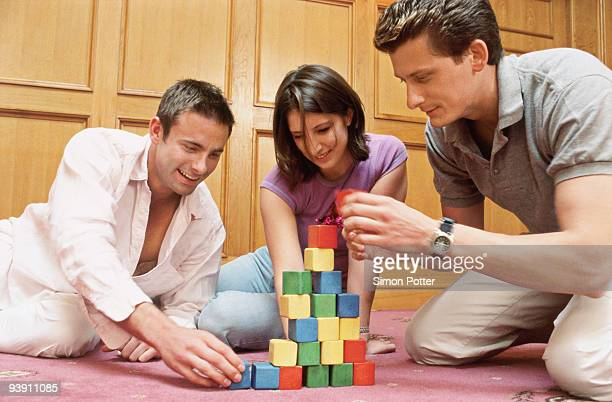 A group building a pyramid with blocks