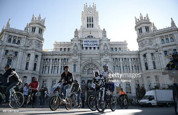 A group called as 'Alliance for Climate' start their journey from the Cibeles Square of Madrid to Paris with their bikes to popularize the use of...