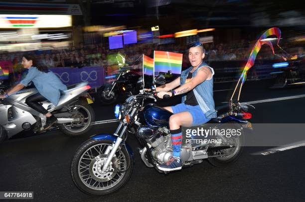 A group calling themselves Dykes on Bikes take part in the annual Gay and Lesbian Mardi Gras parade in Sydney on March 4 2017 Thousands of revellers...
