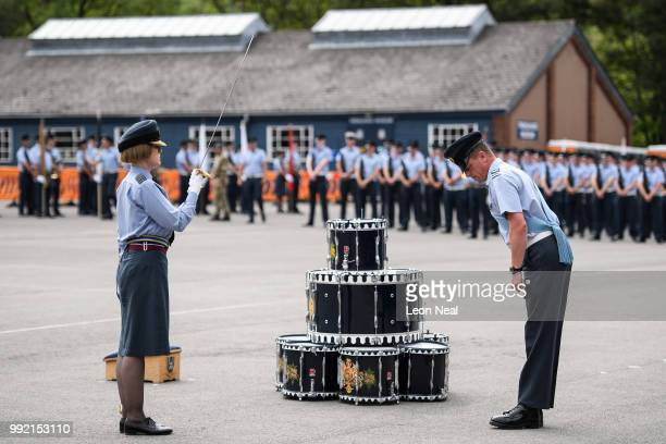 Group Captain AnneMarie Houghton the first female navigator in the RAF is seen as RAF personnel practice their drill manouveres during a final...