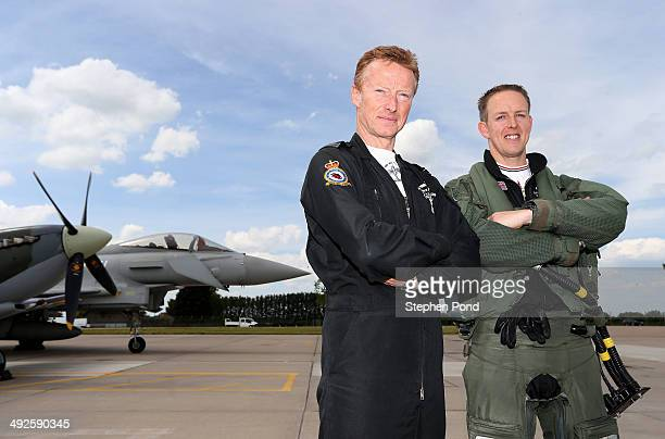 Group Captain Jonny Stringer Coningsby Station Commander and Flight Lieutenant Noel Rees pose alongside an RAF Eurofighter Typhoon and RAF Spitfire...