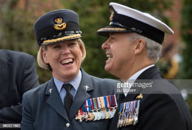 Group Captain Teresa Griffiths the Commanding Officer at DMRC Headley Court and Surgeon Commodore Andrew Hughes share a joke as they attend a...