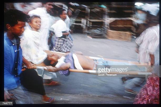 A group carries an unidentified person June 20 1993 in Mogadishu Somalia An estimated 350000 Somalis died due to war famine and disease over the...