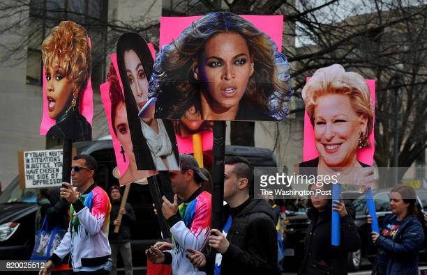 A group carrying images of famous women chanted 'Divas grab back' as they marched on the mall Huge crowds gathered today for the Women's March on...