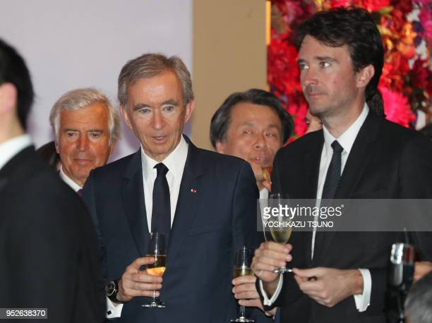 LVMH group CEO Bernard Arnault smiles with his son Antoine at the opening ceremony of Tokyo's new landmark Ginza Six in Tokyo's Ginza fashion...