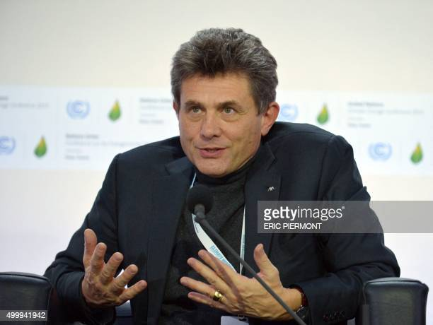 Group CEO Henri de Castries talks during a session at the COP 21 United Nations conference on climate change, on December 4, 2015 in Le Bourget. - At...
