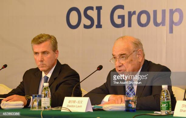 Group CEO Sheldon Lavin and president David McDonald attend a press conference on July 28 2014 in Shanghai China Shanghai Husi Food Co Ltd subsidiary...