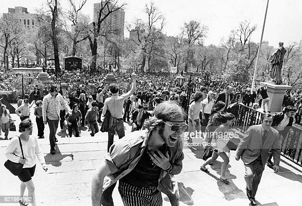 A group demonstrating the shootings at Kent State University in Ohio and the war in Vietnam and Cambodia crowds Boston Common and the steps to the...