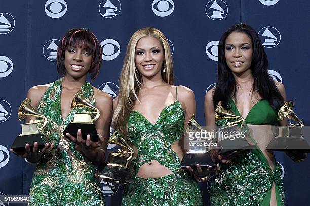 B group Destiny's Child pose with their Grammy Awards for Best RB Performance by a Duo or Group with Vocal 'The Writing's on the Wall' and Best RB...