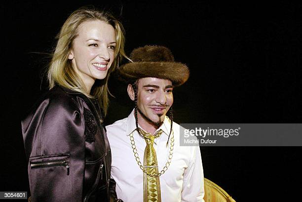 Group Director Delphine Arnault and designer John Galliano are seen backstage at the John Galliano readytowear FallWinter collection 20042005 fashion...