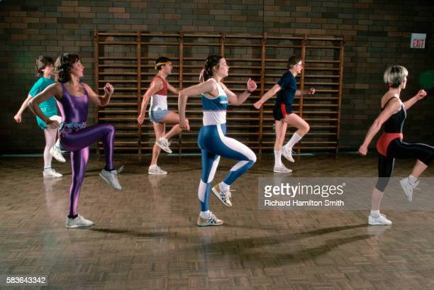 group doing low impact aerobics - aerobics stock pictures, royalty-free photos & images