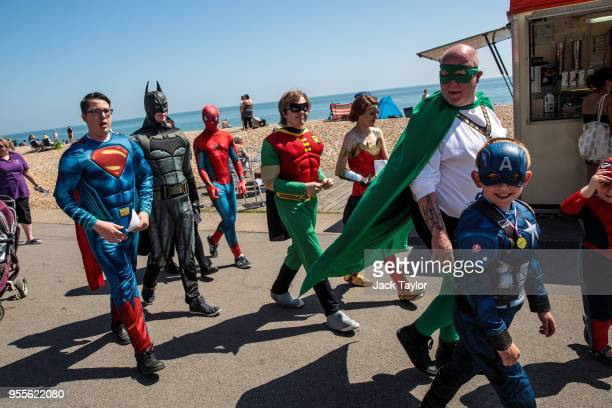 A group dressed as superheroes walk down a promenade during the warm weather on Bank Holiday Monday on May 7 2018 in Bognor Regis United Kingdom...