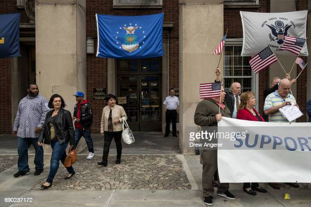 A group exits the building as supporters of Joe Concannon a retired NYPD captain and current candidate for NYC City Council District 23 cheer during...