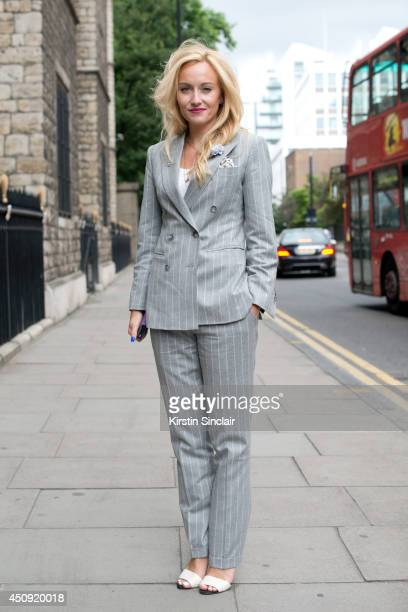 Group Fashion Editor at The Rake Sarah Ann Murray wears a Bespoke suit Zara shoes and H and M top on day 2 of London Collections Men on June 16 2014...