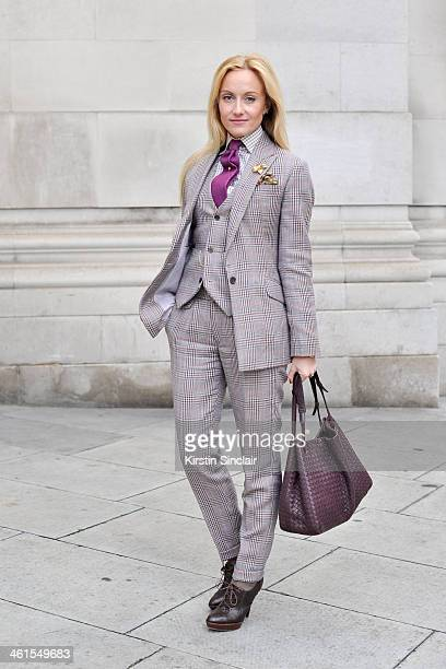 Group Fashion Editor at The Rake Sarah Ann Murray wears a bespoke suit and shirt Drakes tie Bottega Veneta bag and Ralph Lauren shoes day 2 of London...