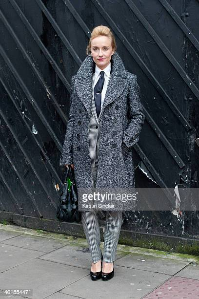 Group fashion editor for the Rake Magazine Sarah Ann Murray wears a Burberry Prossum coat bespoke suit Bally bag LK Bennett shoes and Hermes tie day...