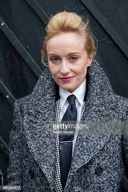 Group fashion editor for the Rake Magazine Sarah Ann Murray wears a Burberry Prossum coat bespoke suit and an Hermes tie day 3 of London Mens Fashion...