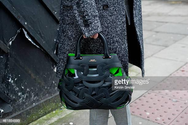 Group fashion editor for the Rake Magazine Sarah Ann Murray wears a Burberry Prossum coat bespoke suit Bally bag day 3 of London Mens Fashion Week...
