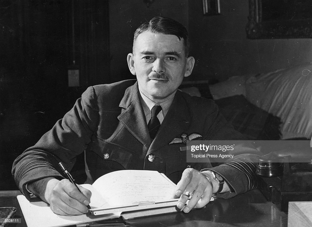 Group Frank Whittle (1907 -1996) inventor of the jet engine at his desk.