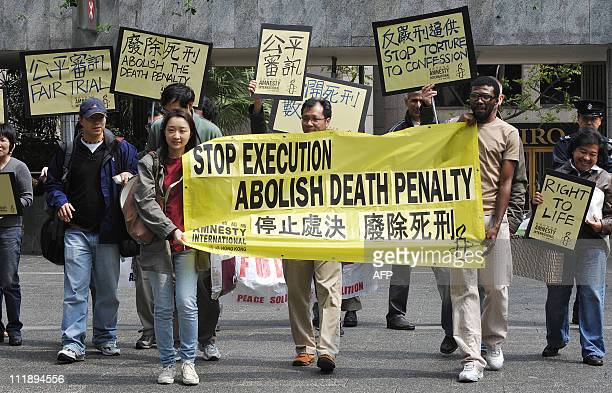 A group from human rights advocates Amnesty International protesting over the death penalty march to the US Consulate and Chinese Liaison office in...