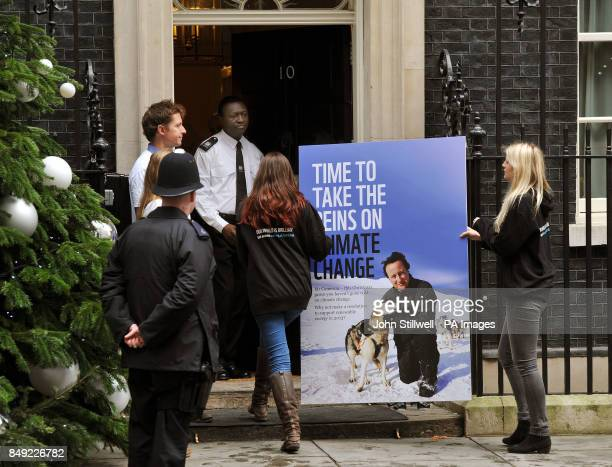 A group from WWF and other Charities hand in a 40000 petition signature giant Christmas card calling on the Prime Minister do do more on climate...