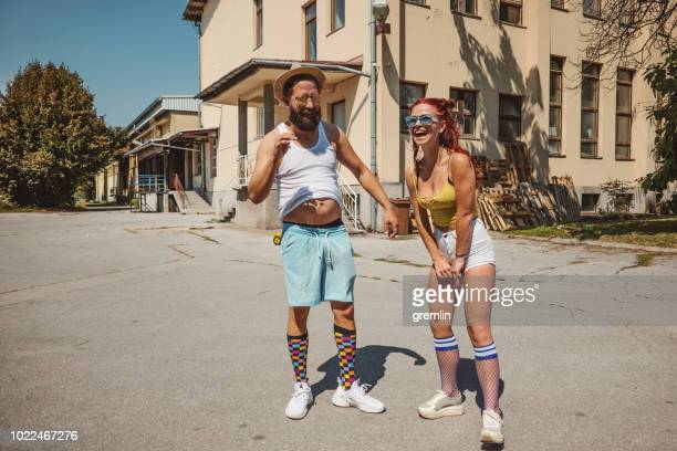 Group funny couple posing outdoors