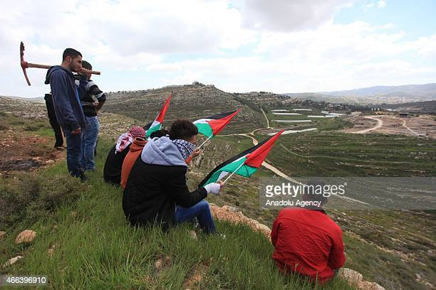 A group gather in Qaryut village located in southeast of Nablus West Bank on March 15 2015 to mark the 12th anniversary of the death of US activist...