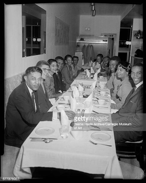 Group gathered around table in Stanley's including on left Mal Goode George Kiseda Ella Baker Pittsburgh Pirates baseball player Gene Baker on right...