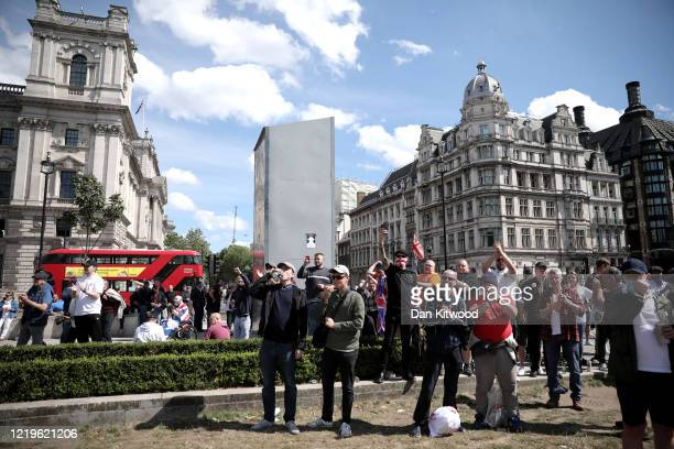 Group gathers around the Winston Churchill statue on Parliament Square on June 13, 2020 in London, United Kingdom. Following a social media post by...