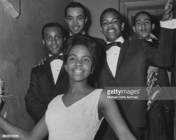 B group Gladys Knight and the Pips pose backstage at the Apollo Theatre circa 1964 in New York City New York