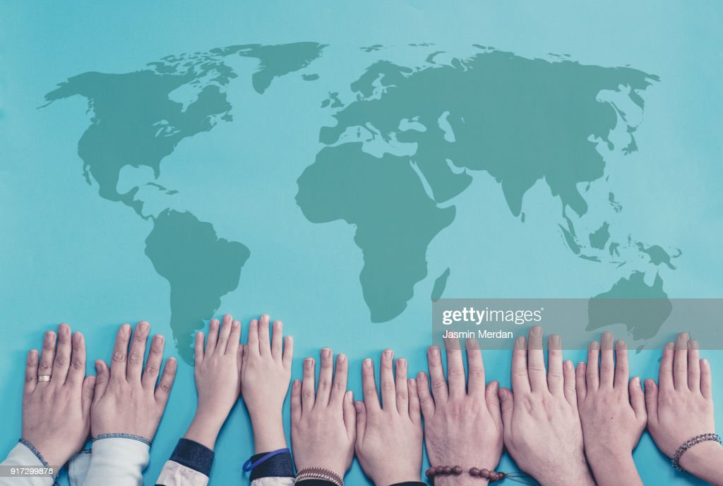 Group hands in circle with world map stock photo getty images group hands in circle with world map stock photo gumiabroncs Image collections