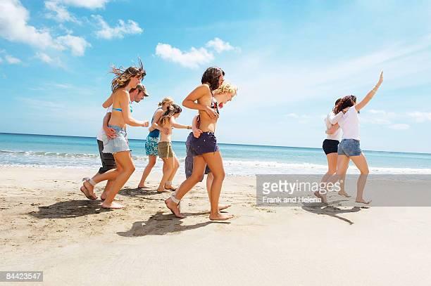 Group having a race on the beach