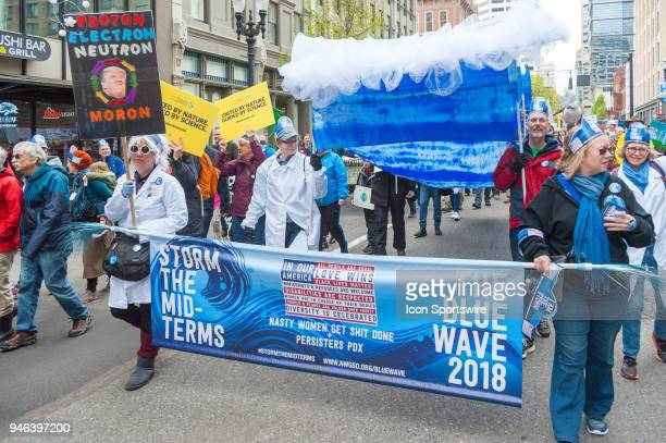 A group in support of the Democratic Party upcoming campaign for the midterms anounces a blue wave at the March for Science on April 14 in downtown...