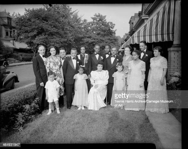 Group including groom George Edward Webster bride Mary Louise Jeffries Webster matron of honor Marian Bannister and flower girls Mildred Webster and...