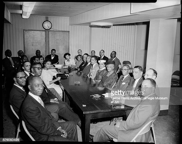 Group including Marion Bond Jordon wearing dark scarf on neck near center Maude Hawkins on left Byrd Brown fourth from left Jim Jordon on right Judge...