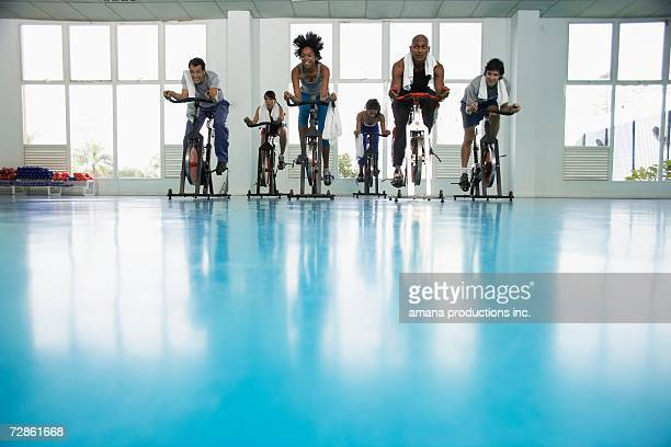 group indoor cycling - exercise bike stock photos and pictures