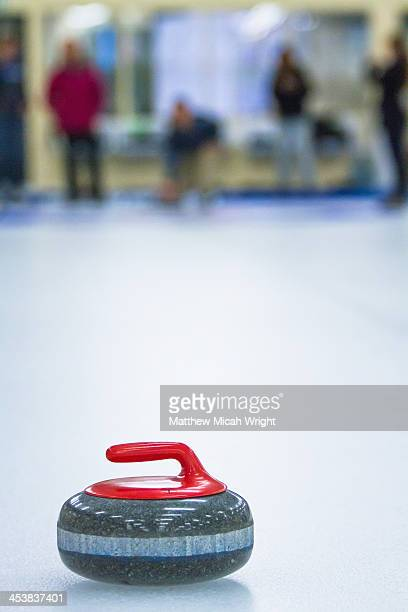 a group learns the sport of curling. - curling stone stock pictures, royalty-free photos & images