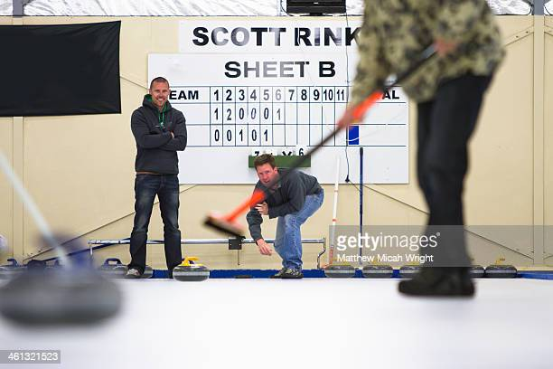 a group learns the sport of curling - curling sport stock pictures, royalty-free photos & images
