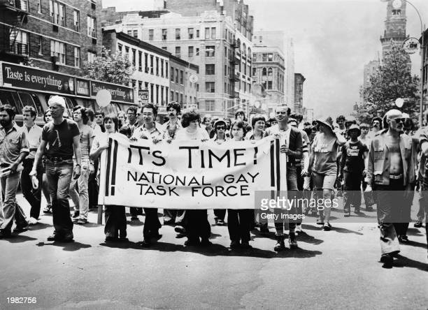 A group led by several people carrying an 'It's Time National Gay Task Force' banner marches up Sixth Avenue during the annual Gay Pride parade in...