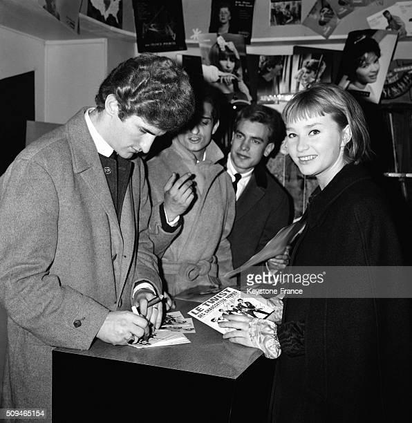 Group Les Chaussettes Noires And Actress Berthe Grandval At A Record Dealer For The Release Of Movie 'Les Parisiennes' - 'Tales Of Paris' - In Paris,...