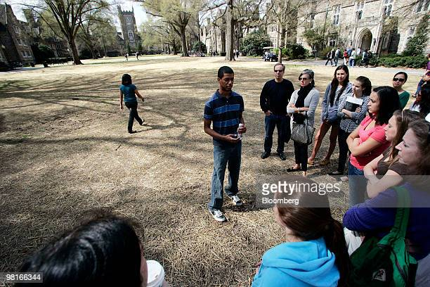 A group listens during a tour of the Duke University campus in Durham North Carolina US on Friday March 26 2010 Duke offered admission this year to...