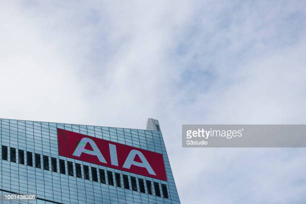 Group Ltd logo is displayed atop at the AIA Central building on July 16 2018 in Hong Kong Hong Kong