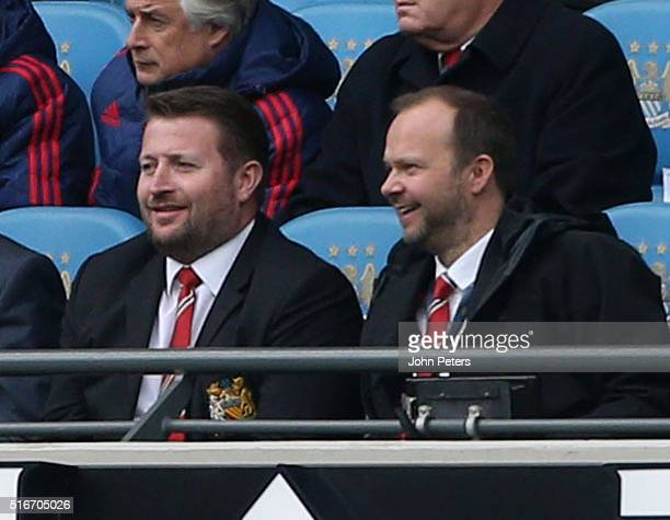 Group Managing Director Richard Arnold and Executive Vice Chairman Ed Woodward of Manchester United watch from the directors box during the Barclays...