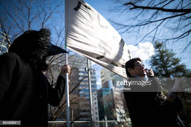 A group member speak to the group of Japanese protesters quotKakuhidoquot before the rally of antiValentine's Day demonstration march in Tokyo on...