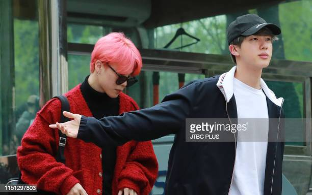 BTS group members Jimin and Kim Seokjin shot before rehearsals for KBS 2TV's Music Bank at KBS' new hall in Yeouido Seoul on April 19 2019 in Seoul...