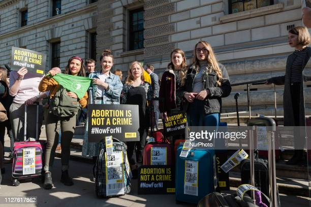 A group of 28 prochoice demonstrators who represent the number of women who travel from Northern Ireland for an abortion each week protest outside...