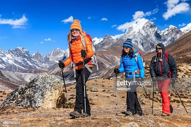 Group of 3 trekkers in Mount Everest National Park, Nepal