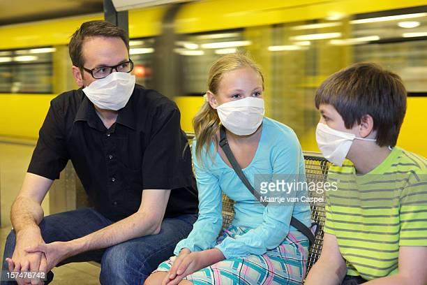 group of 3 with masks on because of swine flu panic - plague stock photos and pictures
