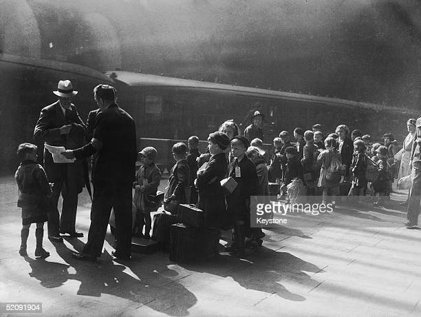 A group of 317 evacuee children wait at a railway station in Liverpool before travelling to safer areas 27th August 1942